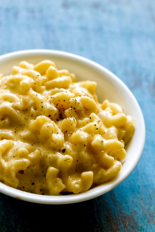close up of the cheese sauce coating the macaroni pasta in a bowl of cheesy one pot mac and cheese