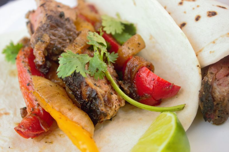 Classic Tex-Mex steak fajitas, skirt steak is tenderized in a powerfully flavorful chipotle-lime marinade and served with bell peppers and onions.