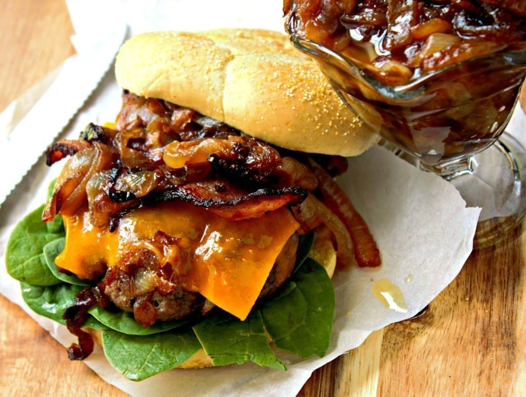 Bacon Burgers with Caramelized Onions - Your new favorite burger. Not only is there bacon on the burger, but IN the burger. The grill isn't ready for this greatness. www.sweetteaandthyme.com