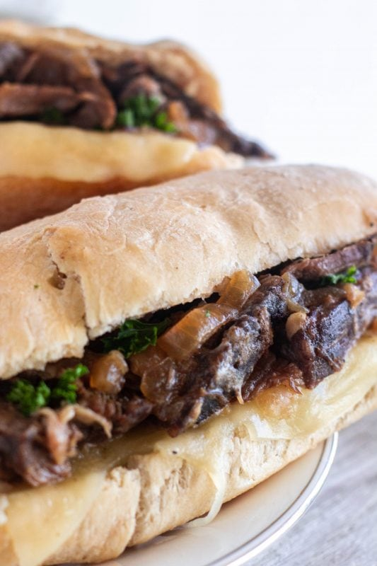 Deliciously drippy French dip sandwiches will be a new favorite in your meal plans. Roast beef sandwiches topped with melty cheese and golden onions dipped in flavorful au jus, it's the best thing to happen to chuck since the pot roast.