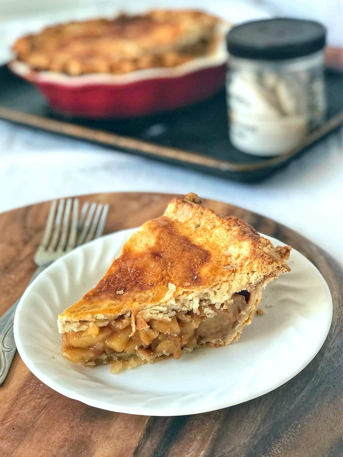 Pie slice. Apple pie from scratch that slices beautifully with amazingly flaky crusts, spiced apple filling that holds its shape, and is perfect for any holiday!