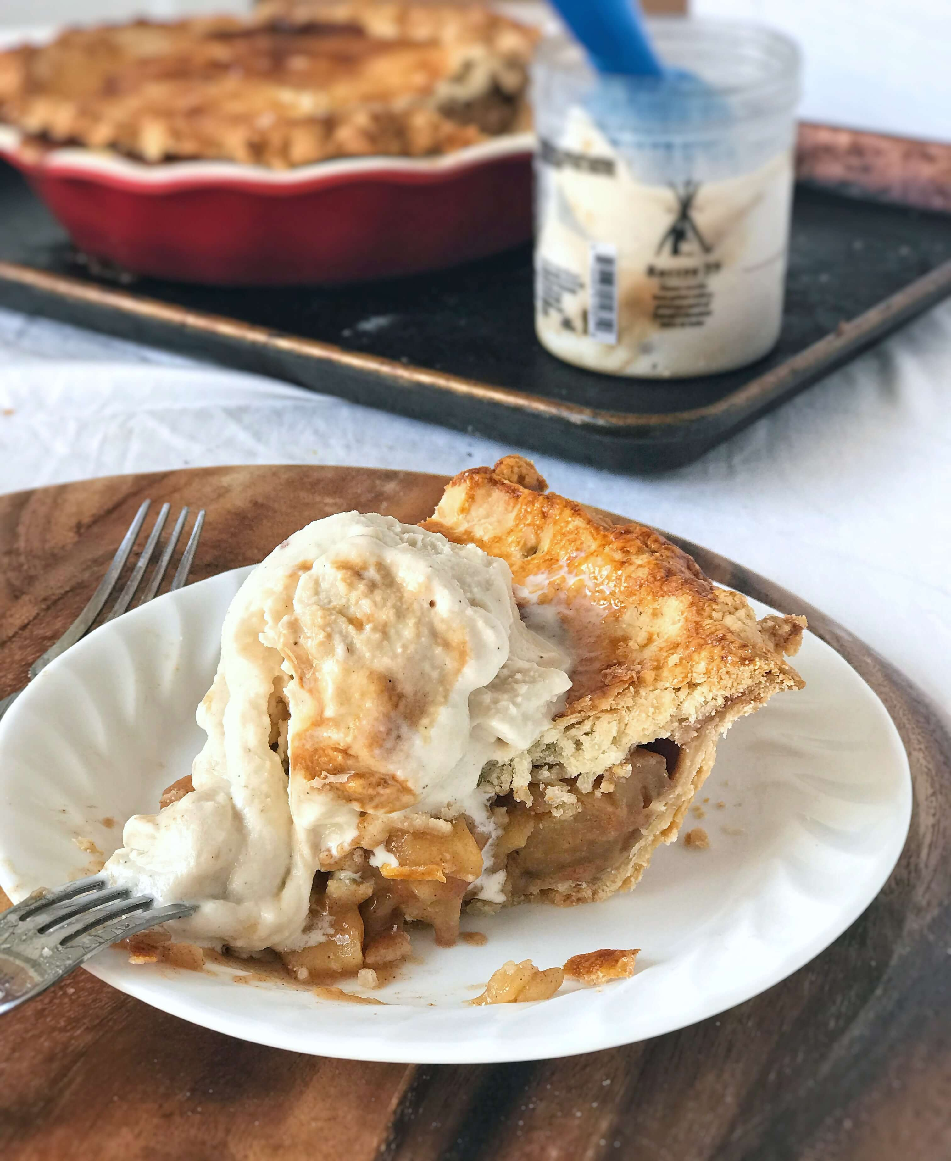 Slice of apple pie with vanilla caramel ice cream. Apple pie from scratch that slices beautifully with amazingly flaky crusts, spiced apple filling that holds its shape, and is perfect for any holiday!
