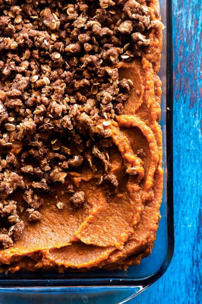 overhead close up of baked southern sweet potato casserole with brown sugar pecan topping