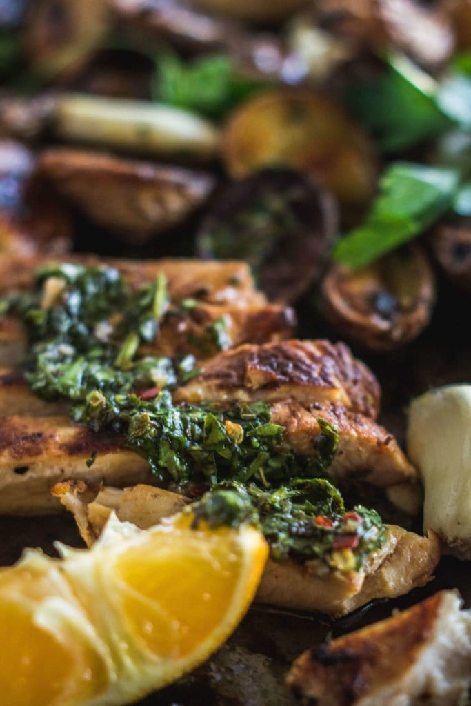 "Dinner is as easy as ""marinate and throw on a sheet pan"". Sheet pan mojo chicken and the potatoes are full of garlicky, citrusy flavor thanks to the mojo and served with herbaceous chimichurri. Dinner is as easy as ""marinate and throw on a sheet pan""."