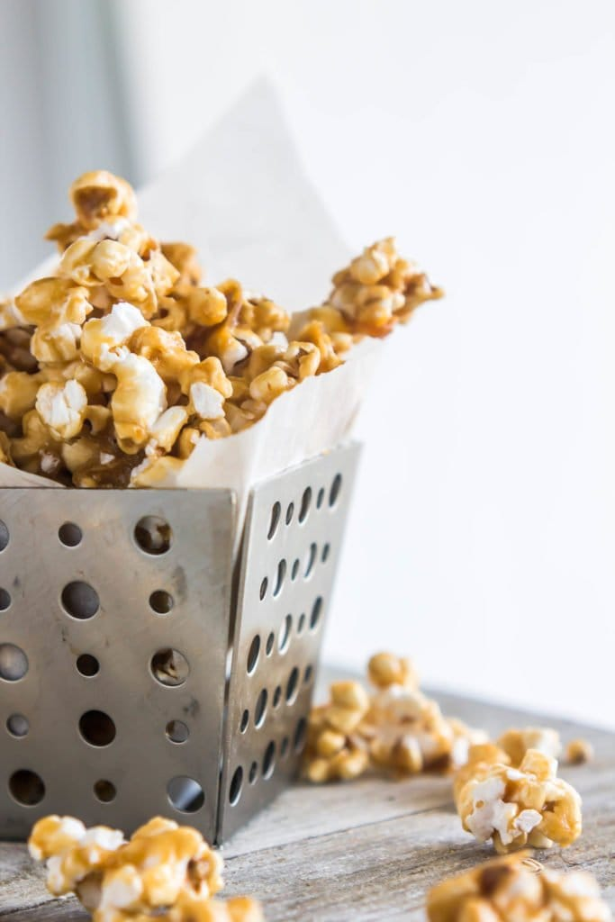 Caramel corn is sweet, crunchy, and super easy to make! The homemade stuff not only tastes better, but is also much more affordable and makes a ton of it to share.