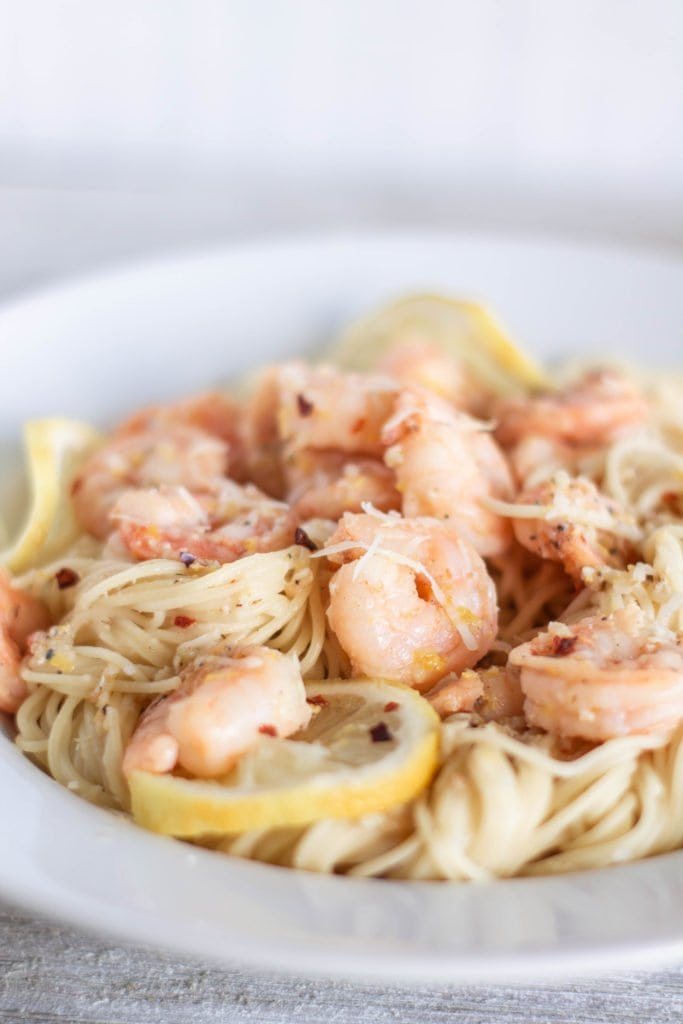 The best shrimp scampi ever! Tender shrimp are sauteed in a delicious butter full of garlicky, lemony goodness, with red pepper flakes for a kick, served up with your favorite pasta that's tossed in that lemon garlic butter in less than 15 minutes. Talk about a winner for dinner!