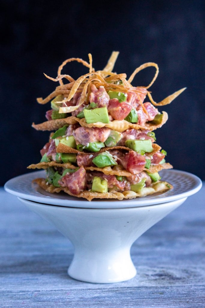 a head on shot of the entire spicy tuna tower with crispy wonton strips on top