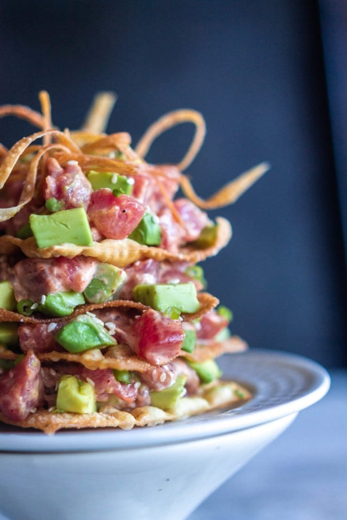 a side view of the tuna avocado towers with crispy wonton layers
