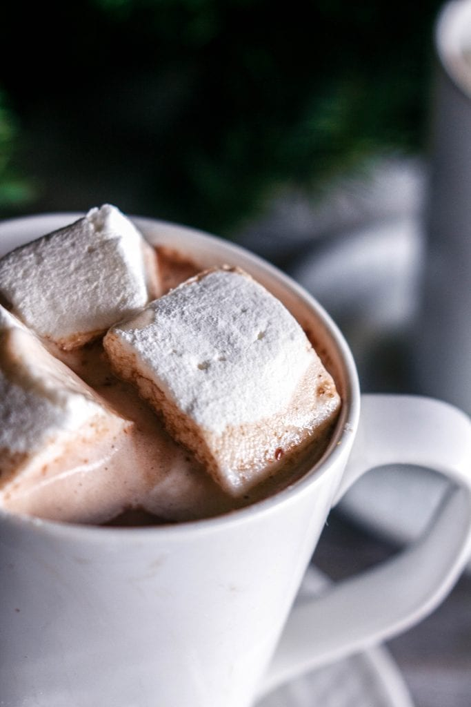 Foolproof Homemade Marshmallows in a cup of hot chocolate on www.sweetteaandthyme.com