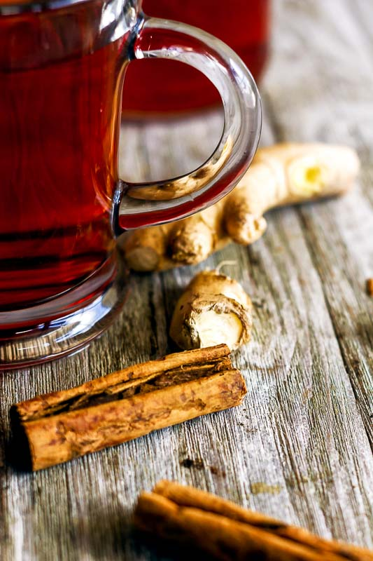 close up of the cinnamon and fresh ginger root used in ginger cinnamon lemon tea