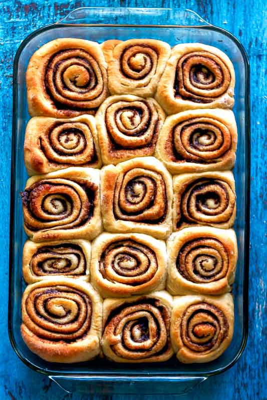 an overhead shot of cinnamon rolls that are better than cinnabon in a glass baking dish