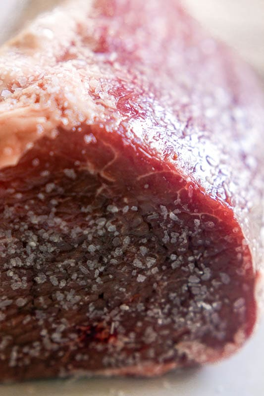 close up of the seasoning on eye of round roast beef