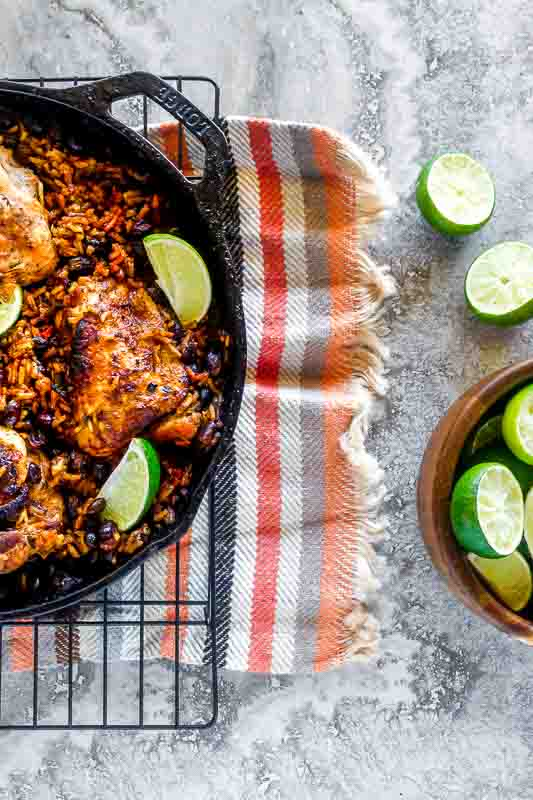over head shot of arroz con pollo in a cast iron pan