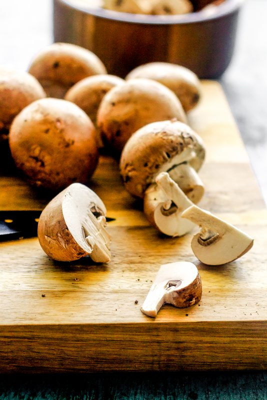 mushrooms being chopped up for mushroom tortellini