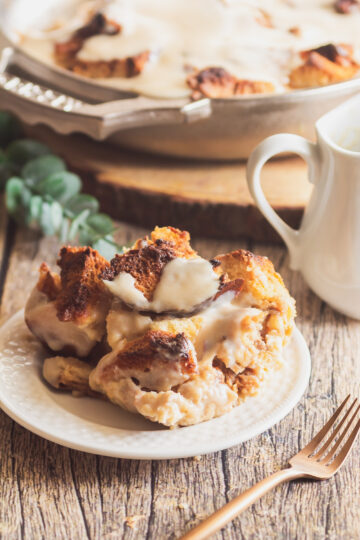 close up of bread pudding on a plate with brown butter bourbon sauce