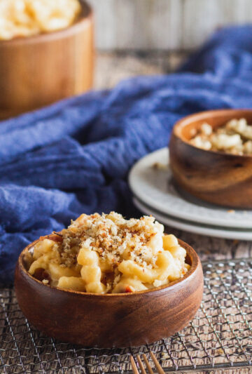 close up of a bowl of bacon mac and cheese with garlic herb breadcrumbs