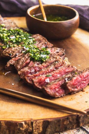 a view of the medium rare churrasco steak sliced against the grain.