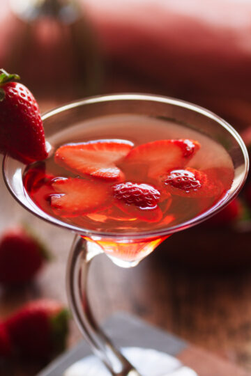 close up view of the love martini's sliced strawberry garnish