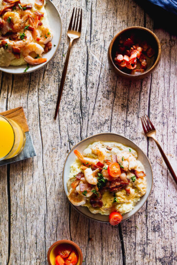the best southern shrimp and grits served with gravy, bacon, and tomatoes