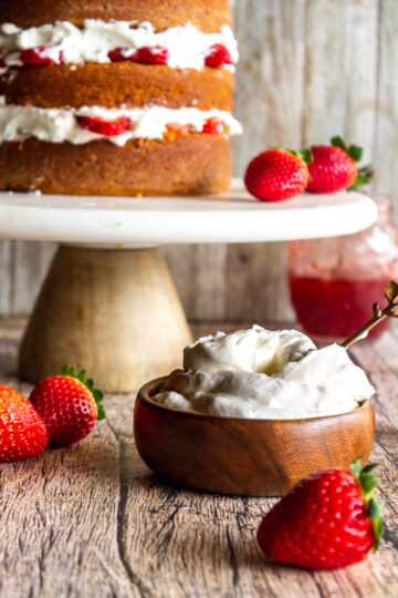 a view of the homemade whipped cream in a small bowl to top the strawberry cake with